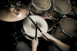Photo of a drummer in action